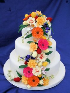cost could be cut by using real flowers - Rainbow Sugarcraft: Spring Wedding Cakes