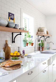 pretty white kitchen with open shelving