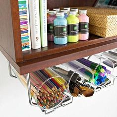 Re-purpose a wine rack into a beautiful organizer for your desk. Place empty cups into the spots that hold the wine. And use the cabinet above to store extra supplies.