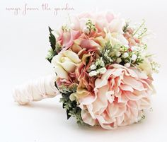 Romantic and elegant, this bridal bouquet includes lily of the valley, real touch roses & peonies and silk hydrangea in shades of pink and ivory. Customize this bouquet to suit your color scheme or or