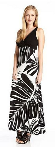 WRAP TOP MAXI TANK DRESS Surplice styling and a floor length silhouette give this Karen Kane maxi dress an easy flattering feel. A coordinating black bodice and palm printed skirt create a perfect pairing for Summer  style. #Karen_Kane #Black #Floral #Maxi_Dress #Summer_2014  #Fashion