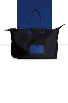 Here is one of the favorite designer handbags for women, made from high-end nylon and leather. This medium-sized tote bag is available in a wide range of canvas-leather color combinations : from the brightest to the most subtle shades. Canvas Leather, Leather Fashion, Designer Handbags, Fashion Bags, Color Combinations, Shopping Bag, Gym Bag, Initials, Shoulder Strap