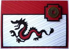 handmade greeting card ... Asian theme ... Cricut cut dragon ... black, white and ret ... lik the embossing folder stripes going one way on top layer and the other way on the card base ... framed metal coin ... great card!!