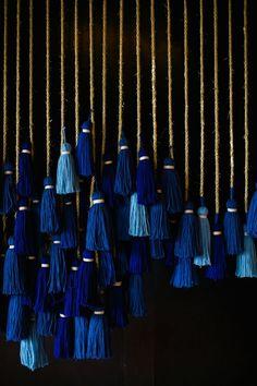 midnight blue tassels - photo by Anna Naphtali http://ruffledblog.com/bohemian-nouvea-wedding-with-midnight-blue #backdrops #backdropideas