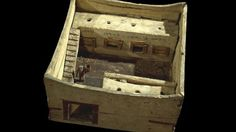A painted wooden model of a granary from Egypt in around 2200 BC