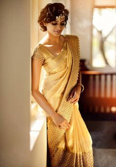 Gold bridal silk saree by Silpaa (Facebook). If you find a simple silk saree in the perfect shade of gold or cream, buy it, then reach out to a boutique to get custom embroidery or border