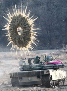 AMAZING MILITARY STAR-BURST SMOKE SCREEN SHELL EXPLODES OVER-TOP SOUTH KOREAN ARMY K-1A1 TANK