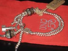UNO-DE-50-HANDCRAFTED-in-SPAIN-BRACELET-with-SILVER-PLATED-BEADS-AND-CHARMS
