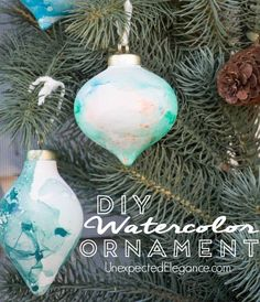 DIY Watercolor Ornaments Using Nail Polish.  These take a minute to make and is a lot of fun for the kids!