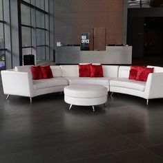 Infinity Sectional with red accent pillows