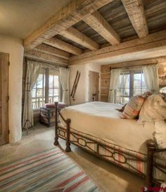 Awesome bedroom...love the ceiling over the bed.