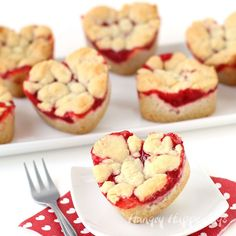 Just 2 ingredients is all you need to make these Heart Shaped Cherry Pie Bars. See this Valentine's Day recipe at HungryHappenings.com.