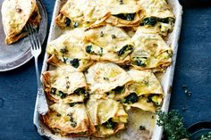 Cheesy spelt crepes stuffed with buttered leek main image