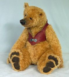 """Barclay is 18"""" and made of Schulte dense matted mohair with trapunto leather paw pads, german glass eyes. he is heavy, floppy, cuddly, filled with silicone beads & woodwool for a modern take with an old-fashioned crunchy feel. sporting a custom made leather vest with pewter clasp. Made by Kelly Dean & Co."""
