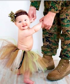 Baby girl with daddy military photo. but with a shirt on