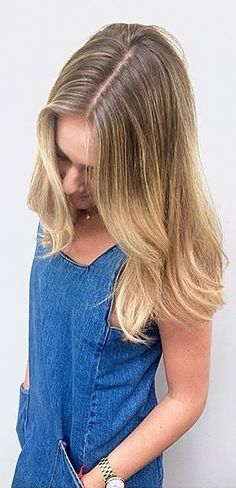 A lovely melt of honey blonde highlights with a rooty blonde base. Color by Mina Kwok.