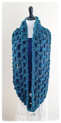 THE NEBULA INFINITY SCARF Materials: ~ Lion Brand Homespun Thick & Quick, 2 skeins of thesame color ~ 19 mm crochet hook Instructions: Work entire scarf with 2 strands of yarn. Chain 60, join ...