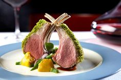 Norwegian Cruise Line Carre d' Agneau Rotis.  Roast Rack of Lamb, Artichokes, Blistered Tomatoes, Zucchini, Green Olive Sauce