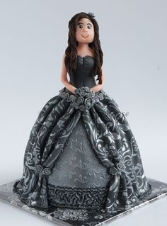 Elegant Lady - just made these for fun. skirt is cake all the rest is fondant and marzipan.