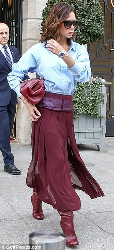 Elegant: With a subtle sheer detail the bold pleated design ensured Victoria, 43, stood out upon her arrival in the French capital