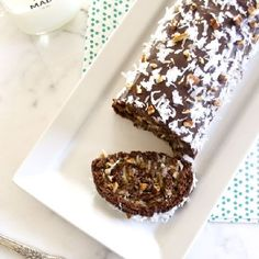 German Chocolate Cake Roll is a genoise cake filled w/ creamy coconut pecan frosting, & topped with ganache.