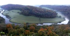 Ethereal: Early-morning mist over the Wye Valley in Herefordshire today gives the autumnal landscape an ethereal quality
