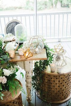 Wood moroccan side table and geometric terrariums with greens