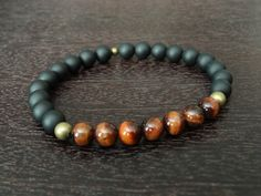 mens protection and power mala bracelet, made from grade a red tigers eye and matte black onyx. tiger's eye is a stone of protection that is