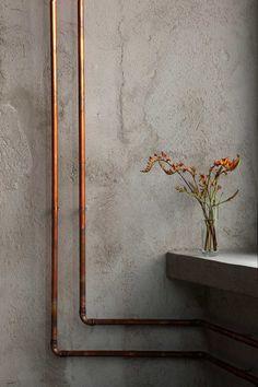 polish restaurant by richard lindvall - copper pipe detail