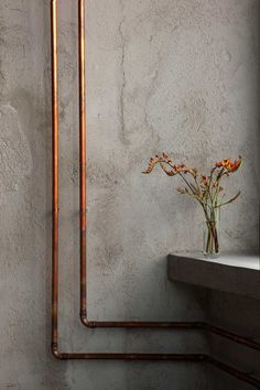 polish restaurant by richard lindvall - copper pipe detail
