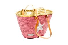 Capazo de mimbre tamaño mediano grande rosa con estrella blanca.  Medidas aproximadas 53 cm x 30 cm