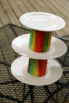 Cup cake stand made of wood, paint and some old plates