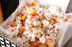 Halloween Popcorn - Put two bags of popped popcorn and a bag of candy corn in a bowl, drizzle 1 package (16 ounces) of white almond bark over the popcorn and candy corn, then spread out on to wax paper. Sprinkle with Halloween sprinkles and let cool 15-30 minutes. Break it up and add peanuts.