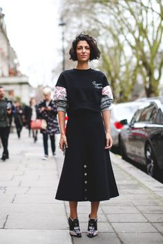 London Street Style That Just Oozes Cool #refinery29  http://www.refinery29.com/2016/02/103453/london-fashion-week-fall-winter-2016-street-style-pictures#slide-28  A sweatshirt and a midi-skirt? Who'd have thought....