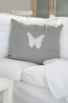 Pillow of gray linen with painted butterfly