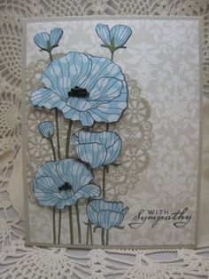 handmade card: Poppies by bettijo (Betty) ...lovely example of paper piecing ... here the flowers were stamped on the card and then on another piece of patterned paper, but out and popped up over the original on the card ... sweet card in light blue and pale gray ... Hero Arts ...