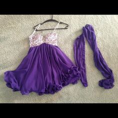Homecoming dress Purple with rhinestones homecoming dress! Super cute and only worn once. Comes with the scarf and I've only worn it once. Size Extra small but fits like a small. I'm a 3/4 in dresses and it fits perfect. Also has a corset in the back to adjust the sizing. Dresses Strapless