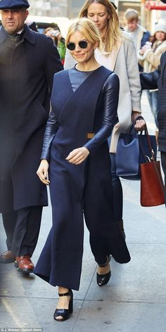 Strutting her stuff: Sienna kept out the New York chill with a skin-tight, long sleeved leather top underneath the sleeveless jumpsuit - while the two garments perfectly matched in colour