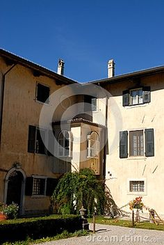 Photo made at the castle and the village of Strassoldo Friuli (Italy). In the image you see two sides in the blue sky, the right one is illuminated by the sun, the castle forming an angle of ninety degrees. At about half the height of the edge a nice little ledge has two finetre arc.