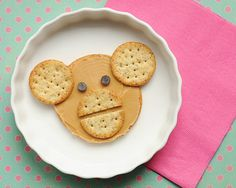 Cute food monkey - Circle crackers—2 sizes, Peanut butter, 2 chocolate chips, Kitchen knife
