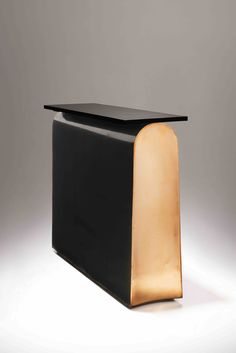 Console Book / Patinated and polished or lacquered bronze.