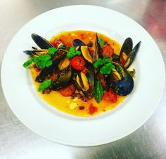 Spring Bay mussels Puttanesca style. Puttanesca sauce with shallotsgarlic  anchovies capers olives fresh chilli roma tomatoes basil and coriander #delicious #instafood #springbaymussels #sustainability #organic #tasmanianmussels #organic #italiancuisine #italiancooking #truecooks #simplydelicious #gastronomia #puttanesca Re-post by Hold With Hope