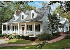 Charming cape cod style home. Love that front porch! #homeexterior