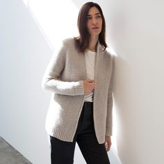 Slipped stitch details at the sides and back add a touch of sleekness to Marmor, a modern cardigan from designer Regina Moessmer. Worked in garter stitch from the top down, Marmor's relaxed elegance is knit into every stitch.