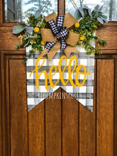 Get ready for spring with this fresh door hanger! Topped with a burlap bow and fresh greenery with a pop of yellow! www.facebook.com/Pumpkinsporch  #spring #doorhanger #plaid