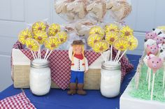 """Strawberry """"sunflower"""" pie pops, horse cookie pops, whoopee pies, and figurine of bday girl"""