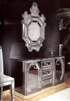 Aubergine walls make the perfect backdrop for the 18th century Venetian server and mirror.