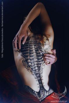 biomechanical corset tattoo by Sebastian Zmijewski