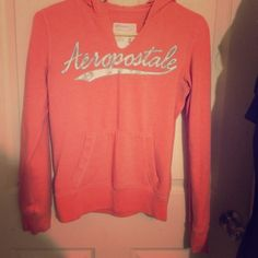 Orange Aeropostale women's pullover Aeropostale women's orange pullover. Size medium has been worn many times as shown by lettering. Small patch sewn shown in third photo. Still in good condition Aeropostale Jackets & Coats
