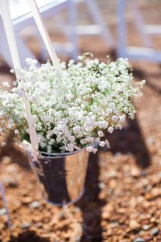 Rustic DIY wedding. Simple decorations for the aisle. Galvanized bucket filled with baby's breath.  Read More: http://www.stylemepretty.com/australia-weddings/2014/07/18/diy-farm-wedding-3/